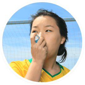 Female soccer player breathing from an inhaler