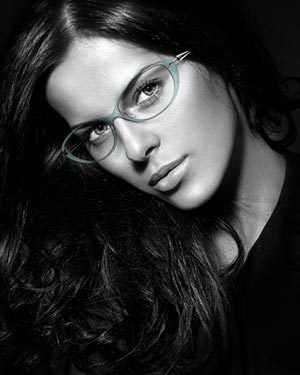 Woman with long hair wearing eyeglasses.