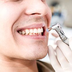 Patient having his teeth polished