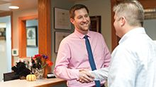 Dr. Salm greeting patient