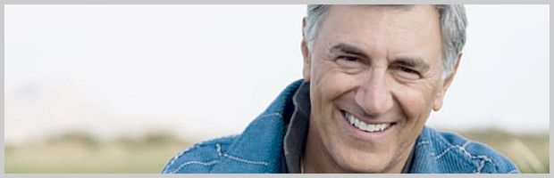 Smiling man in blue denim jacket