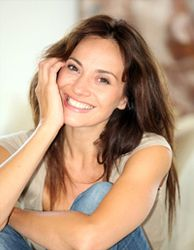 Brunette woman smiling indoors