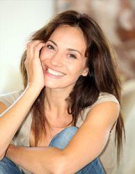 Brunette woman smiling indoors