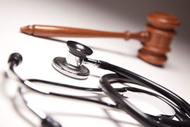 Stethoscope and gavel on a table