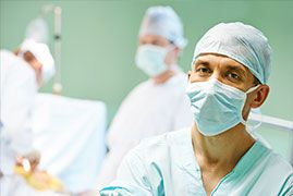 Male surgeon in the operating room