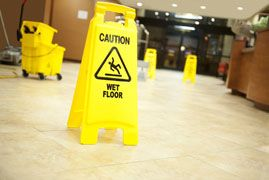 Yellow sign reading 'caution wet floor'