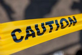 Close-up of yellow 'caution' tape