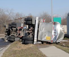 Big-rig truck lying on its side after accident