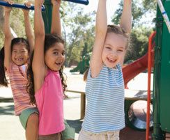 Children playing on jungle gym