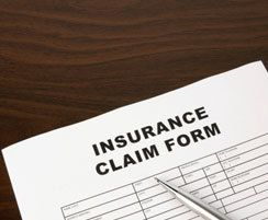 Insurance claim form and pen