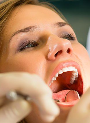 Female patient receiving a dental exam
