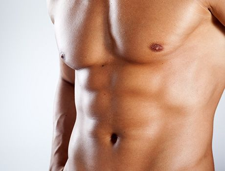 Close-up of a man's muscular abs