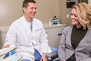 Dr. Hancock discussing Invisalign® with a patient