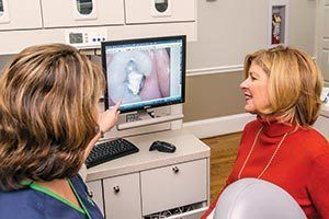 Hygienist at Jerry Hancock, DMD reviewing x-ray with a patient