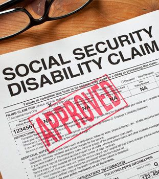Social Security Disability Claim form with a red 'approved' stamp