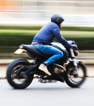 Blurred photo of a motorcycle rider