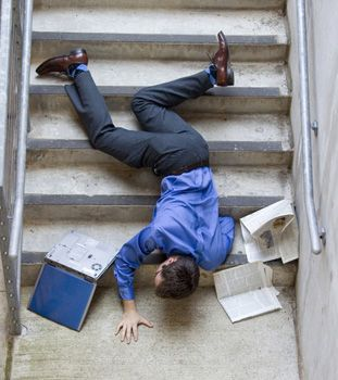 Photo of a man falling down the stairs