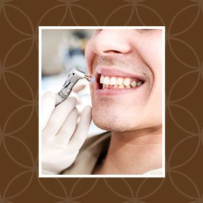 Patient undergoing dental cleaning