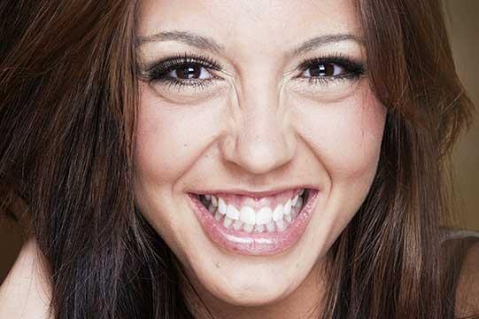Smiling brunette showing teeth