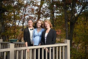 Dr. Susan Dennis and Staff standing on porch in front of trees