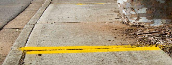 Dangerous, uneven sidewalk.