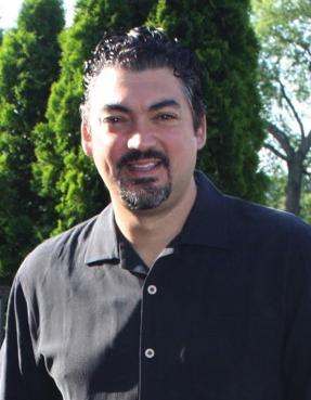 About the Practice: a torso shot of Dr. Ron Direzze