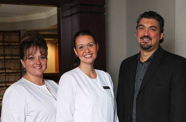 Learn about the practice and team at Shelby Dental: from left to right, receptionist Penny Clark, hygienist Danielle Zolewski, Dr. Ron DiRezze, and assistant Laura Lupescu