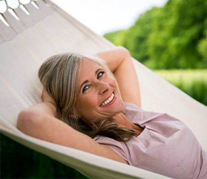 Image of smiling woman in hammock