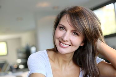 A smiling brunette woman