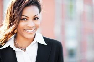 Smiling woman in black blazer
