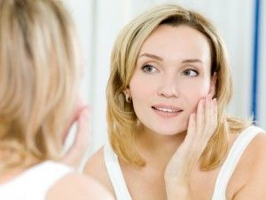 IPL: Woman touching face in mirror