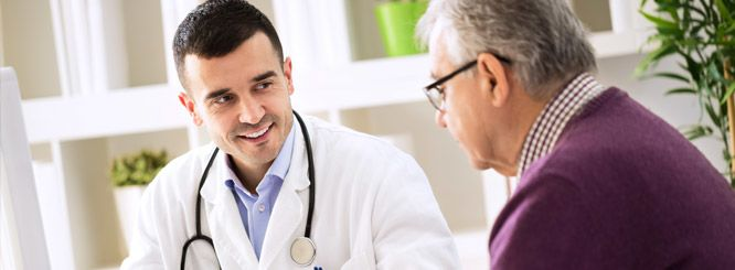 Photo of older man talking to a doctor