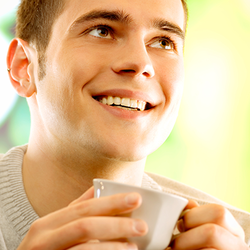 smiling man holding coffee mug