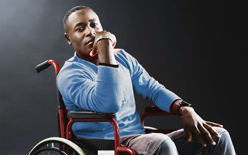 An African American man ponders his new life in a wheel chair after a spinal cord injury