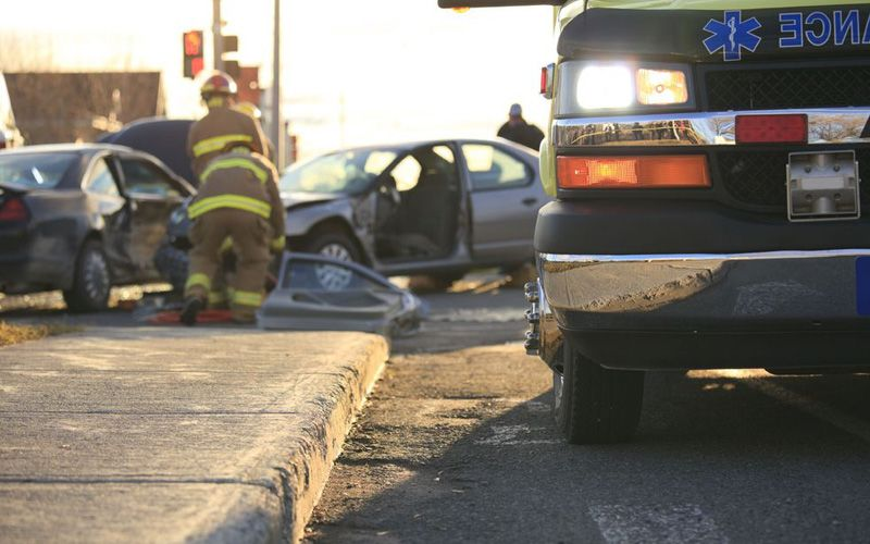 Emergency responders care to a victim of a motor vehicle accident