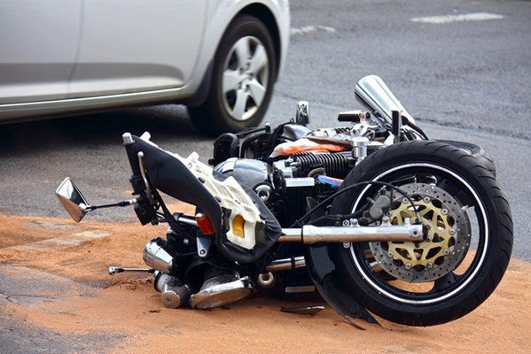 motorcycle laying on ground after crashing