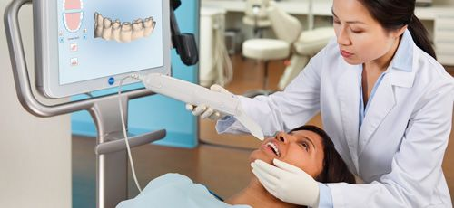 Using dental technology on a patient