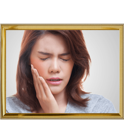 Woman holding her jaw as if in pain