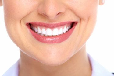 Woman Smiling Following Teeth Whitening Appointment