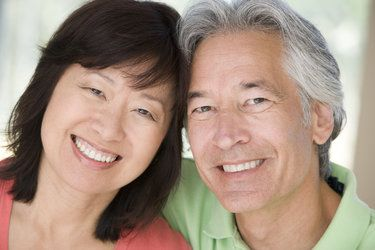 Asian Middke-Aged Couple Smiling