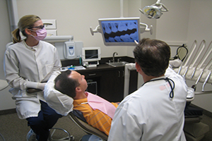 Dr. Craig Goldin reviewing x-rays with patient