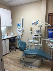 An image of the dental office, dentist's chair, and associated tools