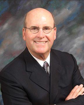 Photo of attorney William Johnson smiling
