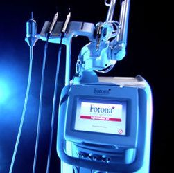 A dental laser against a dark background