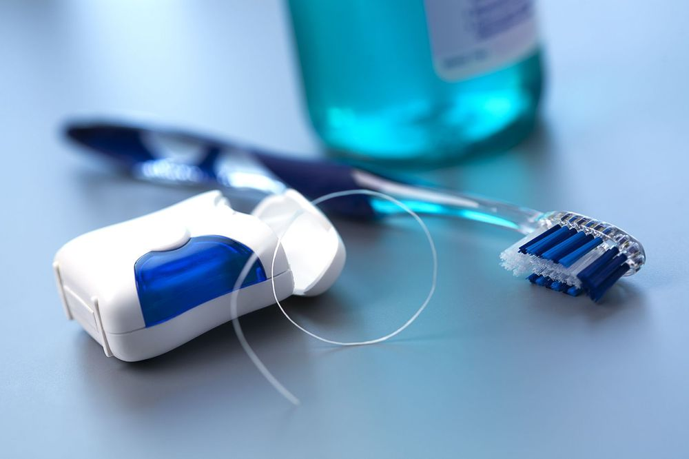 A toothbrush and dental floss
