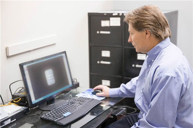 Dr. Long at a computer
