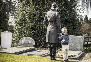 Mom and son at gravesite