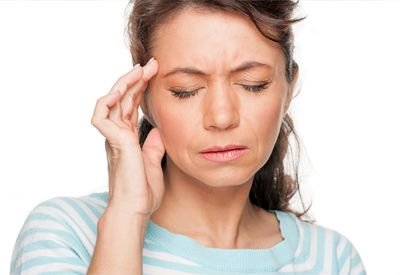 Image of a woman experiencing jaw pain from TMJ