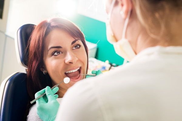 Woman undergoing dental exam