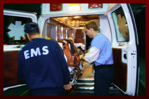 Pedestrian being placed in an ambulance after an accident.